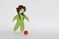 Handmade toy boy playing footbol Royalty Free Stock Image