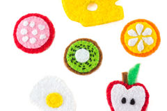 Handmade toy in the form of fruits and food made of felt . Close stock images