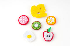 Handmade toy in the form of fruits and food made of felt . Close royalty free stock photography