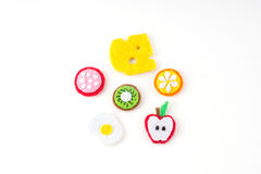 Handmade toy in the form of fruits and food made of felt . Close. Up of crafts with embroidery Stock Photography