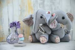 Handmade toy two gray elephants with purple flower. Handmade retro toy two gray colourful elephants with foam eva purple flower handcrafted plush doll furry toy Royalty Free Stock Photography