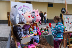 Handmade toys on display for sale. Royalty Free Stock Photo