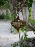 Handmade traditional jewelry made of stones and ropes attached to a tree branch. Handmade jewelry in the Maldives royalty free stock image