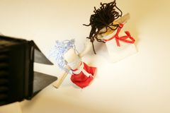 Handmade traditional toys. Color boy and girl during professional shooting Royalty Free Stock Photos