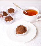 Handmade truffles. And a cup of tea Royalty Free Stock Photos