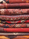 Handmade Turkish Rugs. Red carpets stacked in a traditional store Royalty Free Stock Photography