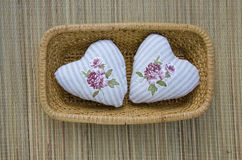 Handmade two clothes heart symbol in wicker plate Stock Photography