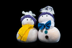 Handmade two snowmen sewn from fabric isolated on. Two snowmen sewn from fabric isolated on black background Stock Photo
