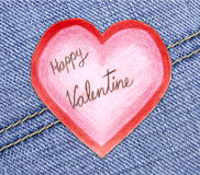 Handmade valentine card with heart. On a jeans background Royalty Free Stock Image