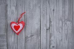 Handmade Valentine heart on wooden wall Stock Photography