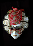 Handmade Venetian mask (red). The colours of the masks are typical of 18th century theatre in Italy Stock Photos