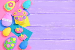 Handmade vibrant felt Easter crafts on lilac wooden background with empty copy space for text. Stock Photography