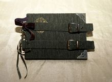 Handmade vintage-looking photoalbum with green cover and bronse clasps.  Royalty Free Stock Photo