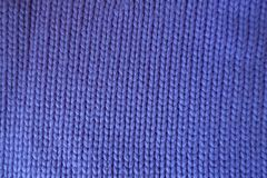 Handmade violet plain knit stitch fabric Royalty Free Stock Photography
