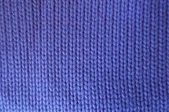 Handmade violet plain stockinette fabric Royalty Free Stock Photography