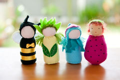 Handmade Waldorf soft toys. Handmade Waldorf soft toys on wooden table with garden in the background. The soft toys are made by me Royalty Free Stock Image