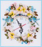 Handmade wall clock decorated with flowers Royalty Free Stock Image