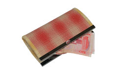 Handmade wallet and Chinese yuan isolated on white background.  Stock Photo