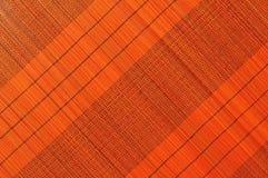 Handmade webbed bamboo napkin background Stock Image