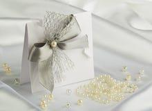 Handmade wedding card. On a white satin fabric Stock Photos