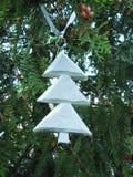 Handmade white decoration hanging on Christmas tree stock images