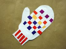 Children create glove from paper Stock Images