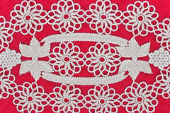 Handmade white lace on red Royalty Free Stock Photography