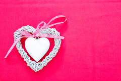 Handmade white wicker heart with ribbon Stock Photography