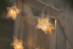 Handmade white wicker star with light bulb Royalty Free Stock Photo