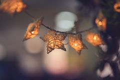 Handmade white wicker star with light bulb Stock Images