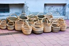 Handmade wicker baskets for sale. Different handmade wicker baskets for sale in the main shopping street in Parnu, Estonia stock photo