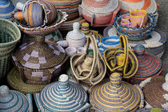 Handmade,. Wickerwork of colored thread on the counter Royalty Free Stock Photography