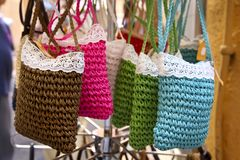 Handmade women bags sold at the market. Street shopping for hand Royalty Free Stock Photos