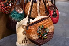 Handmade women bags sold at the market. Street shopping for hand Royalty Free Stock Images