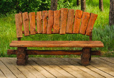 Handmade wood bench in a green park Stock Image