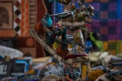 Handmade wood birds from a marketplace Stock Image