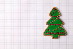 Handmade wood christmas tree decoration on squared paper Stock Image