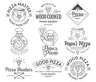 Handmade and wood cooked pizza black on white Stock Images