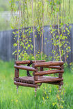 Handmade wood swing. Made of black alder wood Royalty Free Stock Images