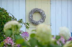 Handmade Wood Vine and Star Fish wreath hanging on a New England Stock Photography
