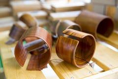 Handmade Wooden bracelets on wooden background Stock Images