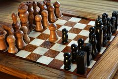 Handmade wooden chessboard. Depicting stragegy, thought, intelligence and luxury Stock Photo