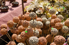 Handmade wooden and clay balls ornaments on stick Royalty Free Stock Photo