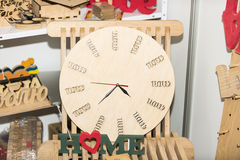 Handmade wooden clock. With wooden decoration stock image
