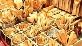 Handmade wooden cutlery. Exposed in a thai market stock video footage
