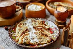 Wooden dishes and food Royalty Free Stock Image