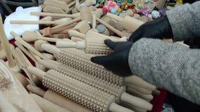 Handmade wooden kitchen utensil tool pin hand glove market fair stock video footage