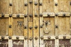 Handmade wooden knob. Knob handmade wooden old wooden door, construction Stock Photos