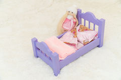 Handmade wooden miniature sofa for dollhouse Royalty Free Stock Photo