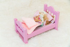 Handmade wooden miniature sofa for dollhouse Royalty Free Stock Photos